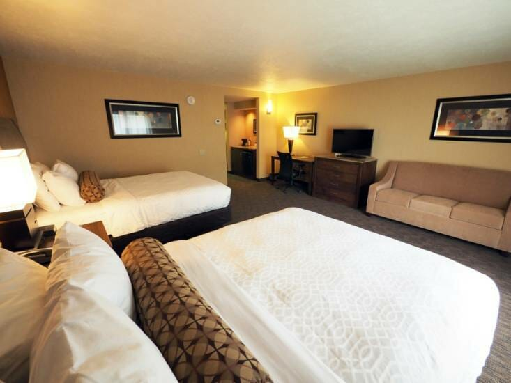 Hotel room showing two queen size beds at Evergreen Resort in Cadillac