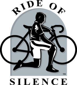 Man kneeling next to a bike