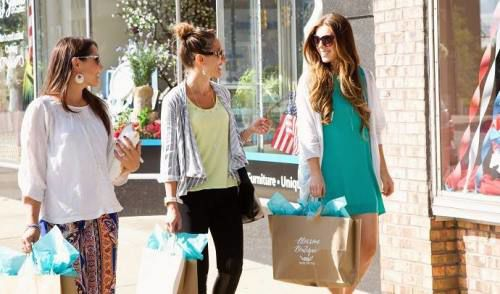 3 women with shopping bags, shopping in downtown Cadillac Michigan