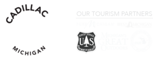 Cadillac Tourism Logo with logo of partners - pure michigan, michgian dnr, west michigan tourism association, us forest service, michigans great outdoors