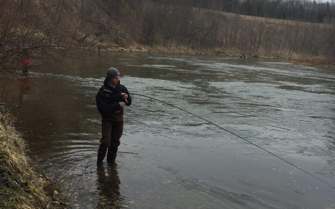 Parker McNitt fishing on river